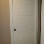 porta pantografata montata interno muro