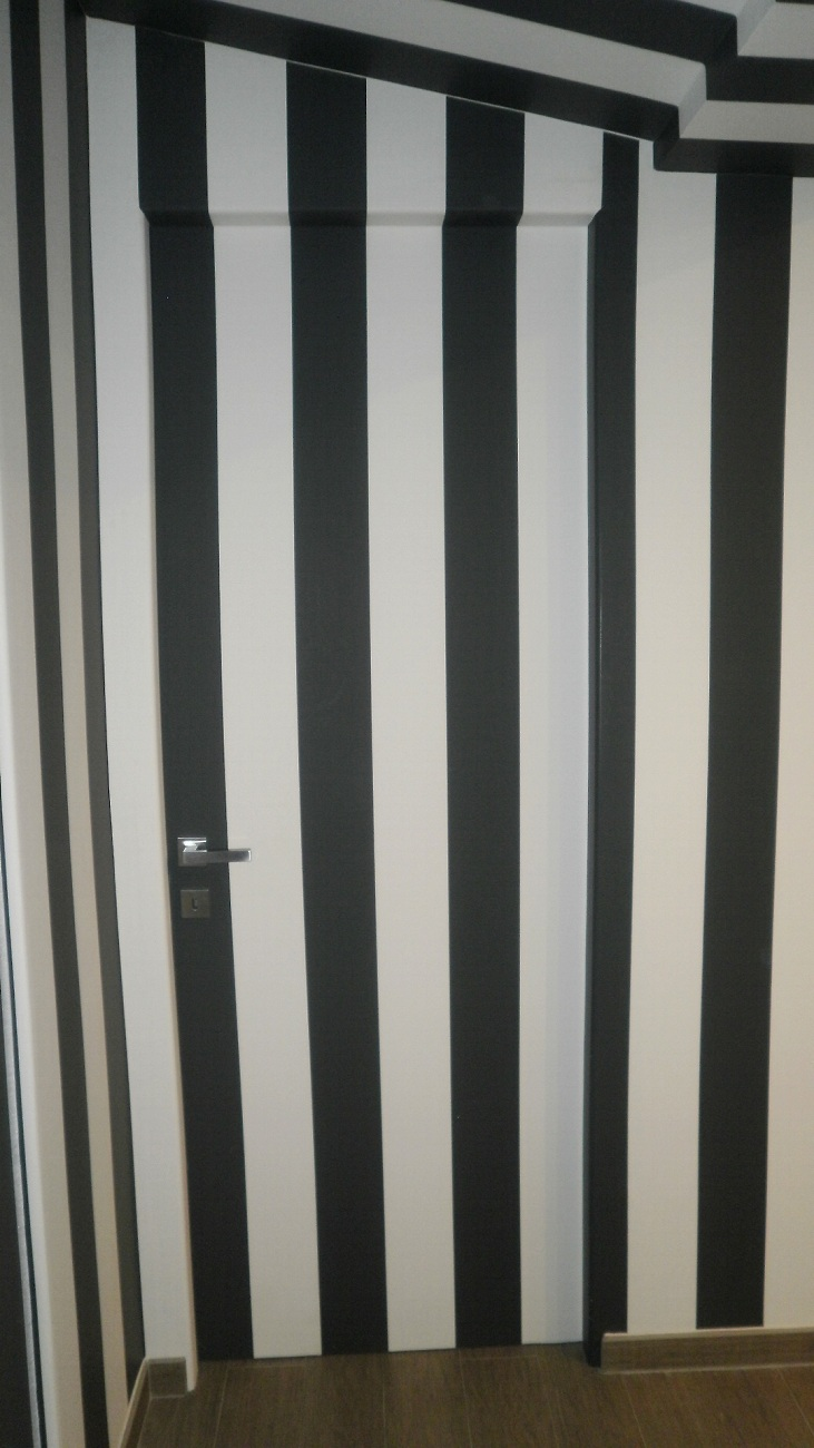 Porte falegnameria nuova pretolani for Carta da parati per porte